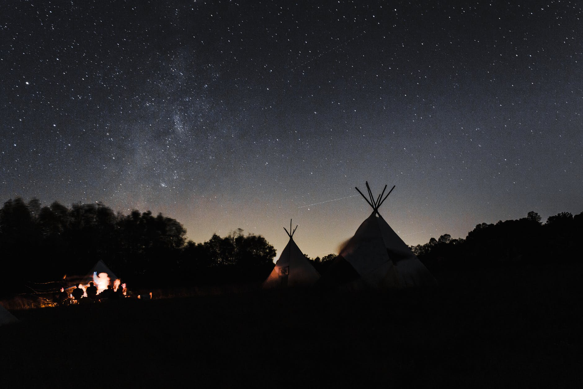 tent under starry night sky